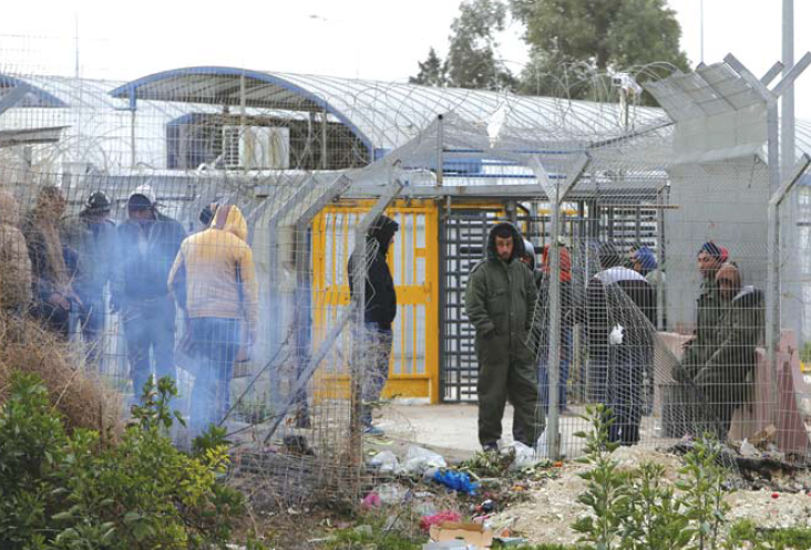 Hebron – Group of Palestinian Civilians at Israeli Checkpoint.
