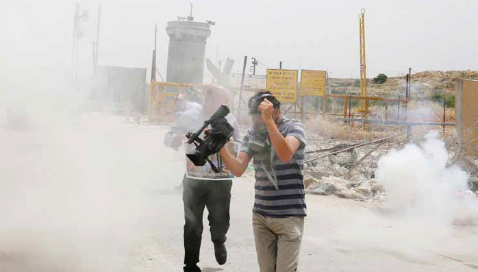 Israeli Forces Fire Tear Gas Canisters at Journalists in Front of Ofer Prison.